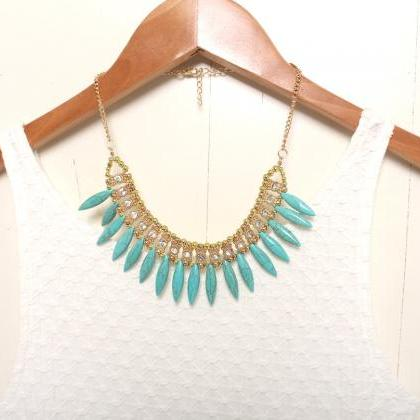 Tribal white statement necklace, go..