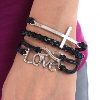 Black friendship charm bracelet with love, cross and infinity charms